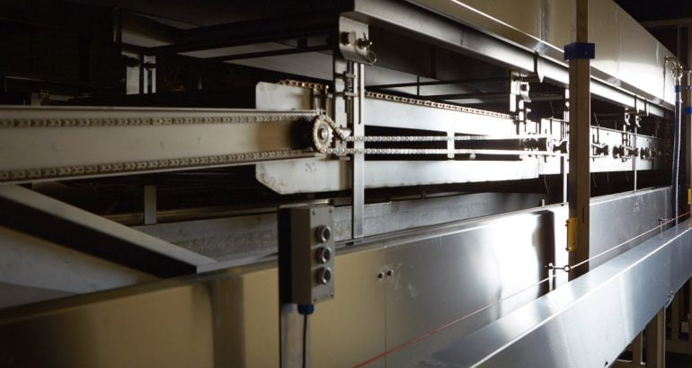 Maintaining oil quality in industrial frying process systems