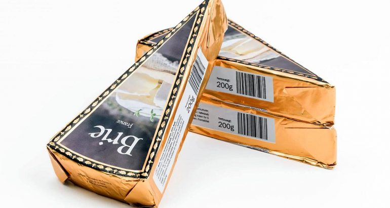 Compostable flexible packaging from paper laminate to produce wraps