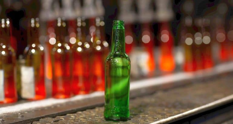 Glass industry sustainable packaging for bottles to zero carbon footprint ambition