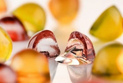 Gummy cap format: appealing of a gummy, efficient delivery of a capsule